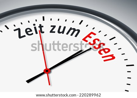 An image of a typical clock with text time to eat in german language