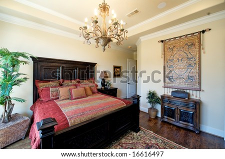 An image of a very upscale bedroom - stock photo