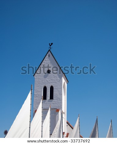 An image of a white church in the swedish town of Torekov.
