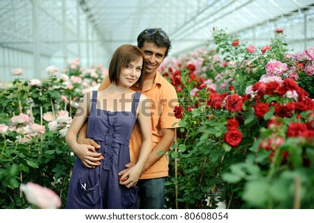 An image of a woman and a man in greenhouse