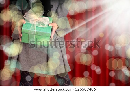 an image of a woman holding gift box
