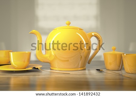An image of a yellow teapot and teacups - stock photo