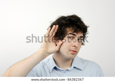 An image of a young man listening to something - stock photo