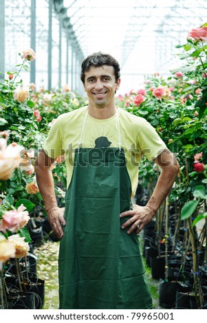 An image of a young worker in a greenhouse - stock photo