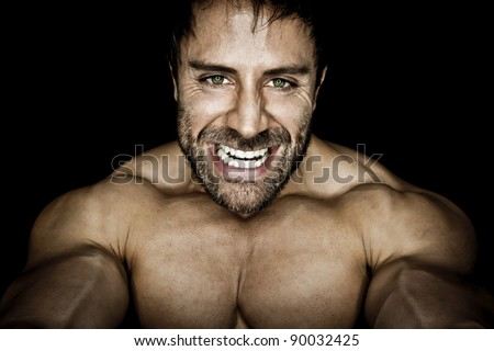 An image of an angry muscular sports man - stock photo