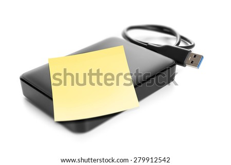 An image of an external hard drive with space for your message - stock photo