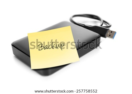 An image of an external hard drive with text backup - stock photo