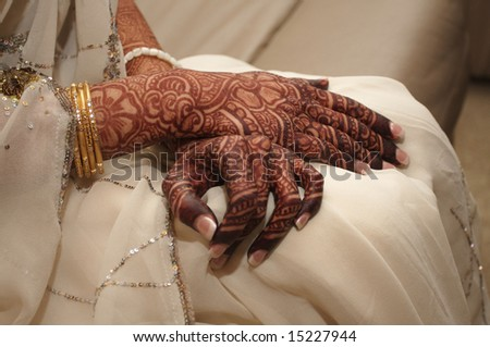 An image of an Indian bride's hands covered in henna - stock photo