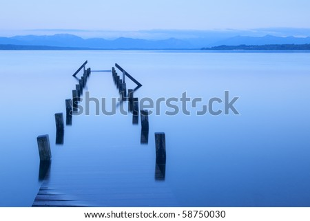 An image of an old wooden jetty at Starnberg lake - stock photo