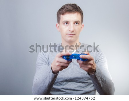 An image of boy holding joystick and playing games