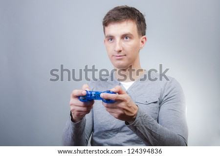 An image of boy holding joystick and playing games - stock photo