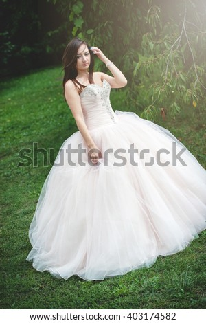 an image of bride in the park