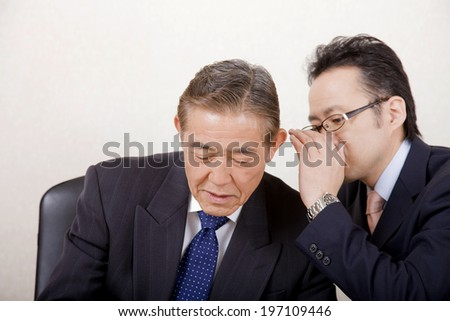 An Image of Business Man Whispering - stock photo