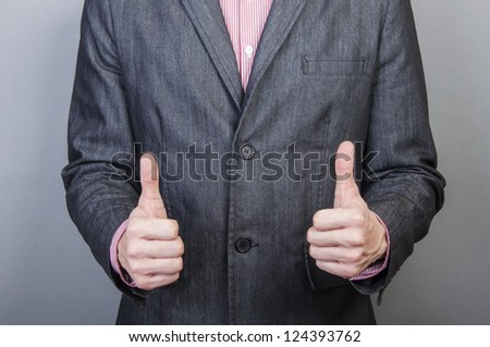 An image of Businessmen handshake  isolated on gray background - stock photo