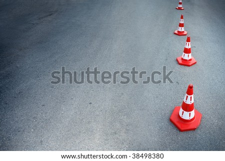 An image of cautions on asphalt road - stock photo