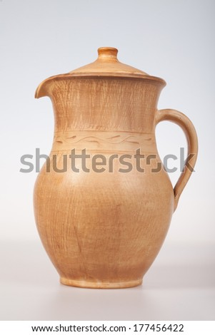 An image of ceramic jug on a white background - stock photo