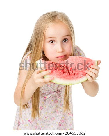 an image of child eating watermelon