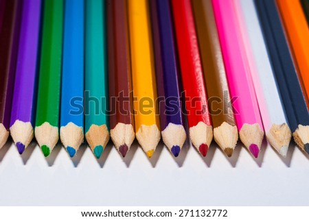 an image of Colour pencils isolated on white background close up - stock photo