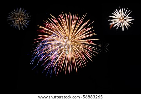 An image of fireworks display in the dark.