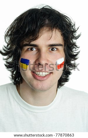 An image of football fan with flags on face - stock photo