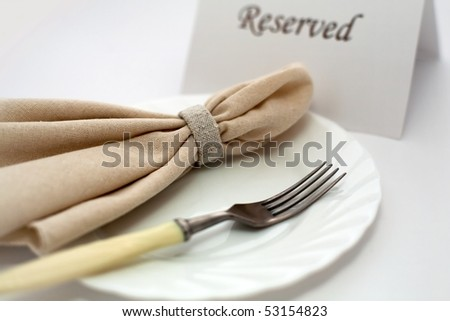An image of fork and napkin on plate - stock photo