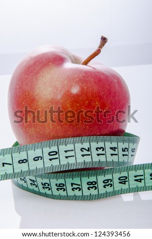An image of fresh red apple and centimeter