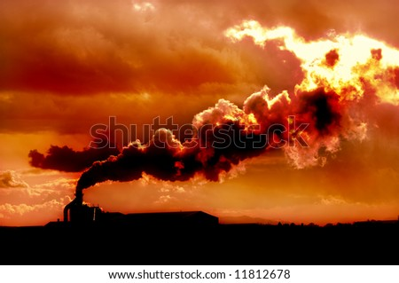An image of global warming smoke rising from factory