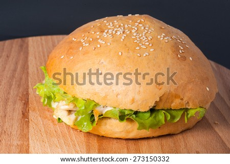 an image of grilled hamburger on wooden board