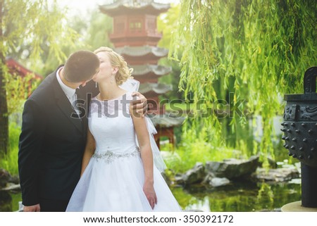 an image of groom and bride session outdoor in the garden