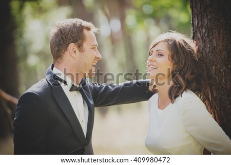 an image of happy bride and groom outdoors in the forest