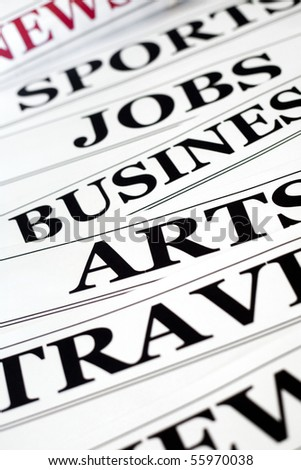 An image of headlines in the newspaper - stock photo