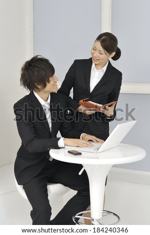 An image of Japanese coworkers meeting