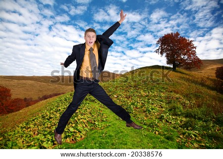 An image of jumping men. Background of hill with tree