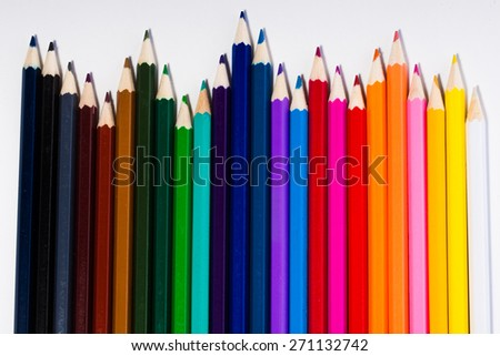 an image of line of colored pencils - stock photo