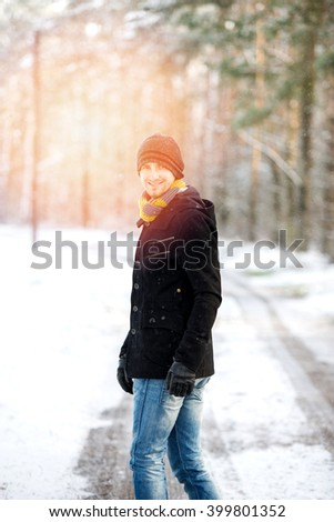 An image of man during winter walk in forest - stock photo