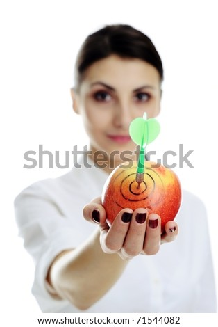 An image of nice girl holding apple with dart. - stock photo