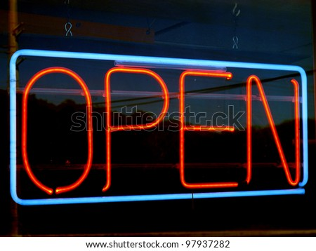 an image of open neon sign at night - stock photo