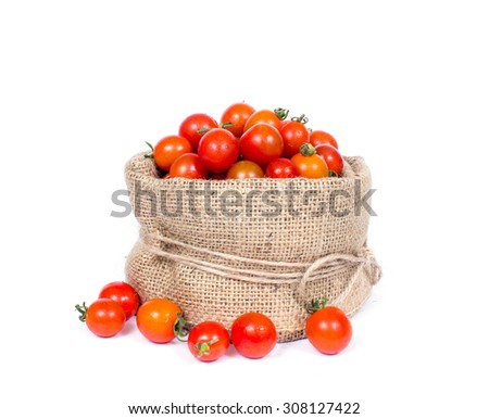 an image of organic tomatoes in basket - stock photo