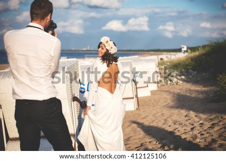 an image of portrait of beautiful bride and groom at the beach