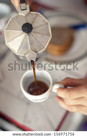An image of pouring Italian coffee - stock photo