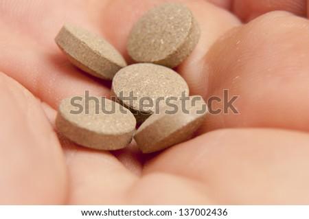 An image of sedative pills on white background - stock photo