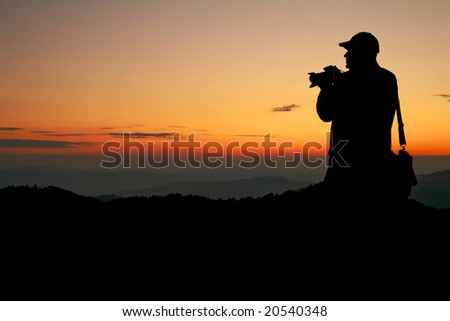 An image of silhouette of a man on a rock