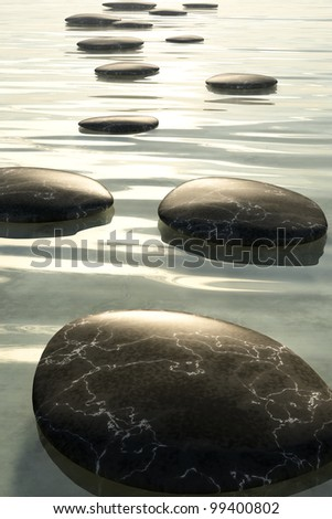 An image of some nice black step stones in the sea - stock photo