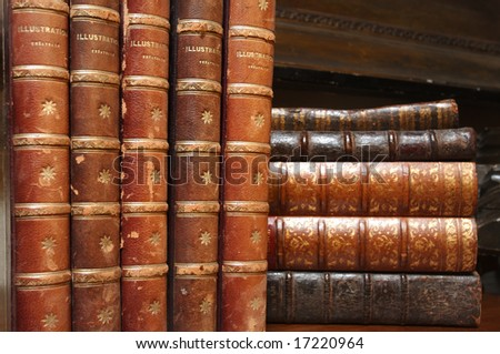 An image of stacks of antique books - stock photo