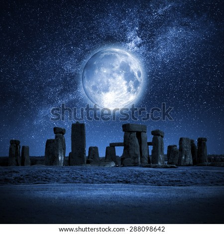An image of Stonehenge with a full moon - stock photo