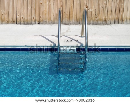 An image of swimming pool and ladder