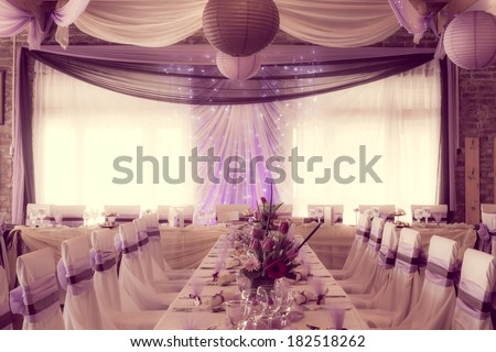 an image of tables setting at a luxury wedding hall - colorized photo - stock photo