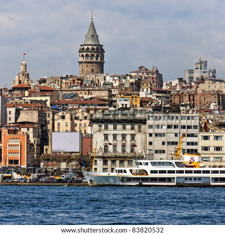 An image of the ancient but well preserved galata tower situated in the turkish city of Istanbul. - stock photo