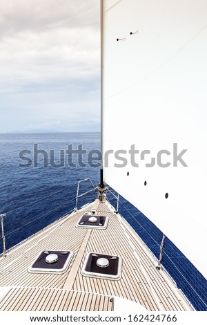 An image of the front of a sailing boat - stock photo