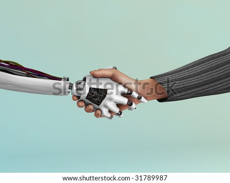 An image of the handshake between a robot and a human being. - stock photo